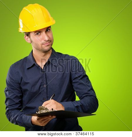 Male Architect Writing On Clipboard Isolated On Green Background
