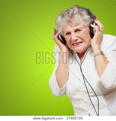 Angry Woman Clenching His Teeth On Green Background