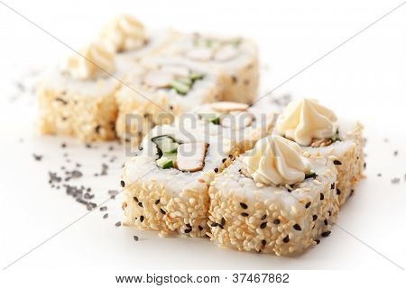 Maki Sushi - Roll made of Meat and Cucumber inside. Sesame ouside. Topped with Cream Cheese