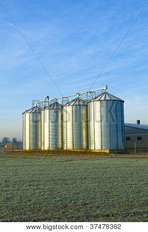 Field In Harvest With Silo
