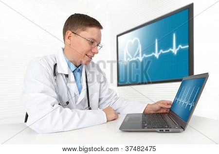 Doctor With Laptop Computer. Heart Beat