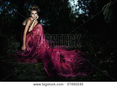 Fairy Tale - Beauty Woman In Fashion Red Dress Sitting In Forest