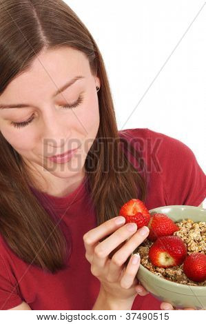 Pretty girl eating a fruit salad
