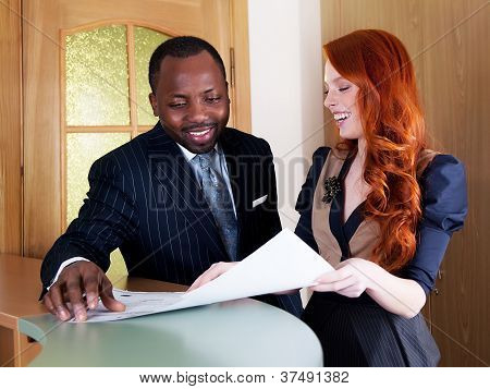 Red Hair Young Businesswoman And Black American Businessman