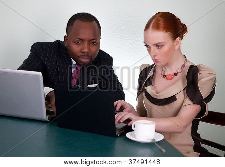 Business Conversation Between Black Man And Redhead Woman