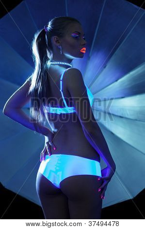 Beauty Girl with ultraviolet make-up in sexy dance