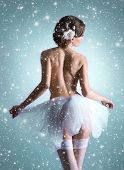 stock photo of nu  - Young beautiful ballet dancer over Christmas background - JPG