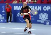 KUALA LUMPUR - SEP 28: Nikolay Davydenko plays his quarter-final match at the ATP Tour Malaysian Ope