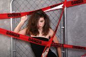 picture of frazzled  - Beautiful Young Woman Wrapped in Danger Tape - JPG