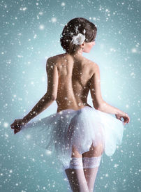 foto of nu  - Young beautiful ballet dancer over Christmas background - JPG