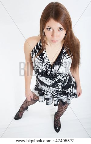 Young beautiful girl in a smart dress