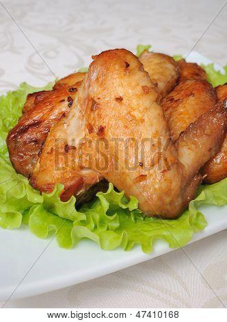 Cozido de asas de frango com alho