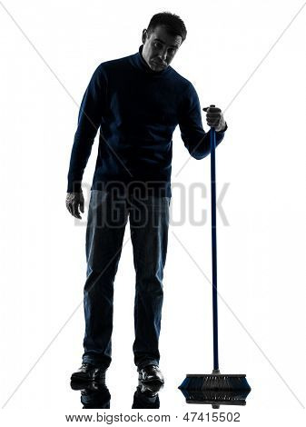 one caucasian man janitor brooming cleaner boredom full length in silhouette studio isolated on white background