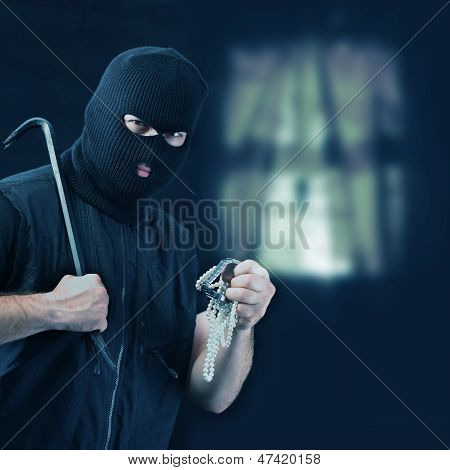 Masked Thief Stealing Jewelry