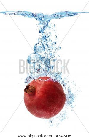 Pomegranate Splashing In Water
