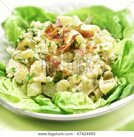 Potato Salad With Letuce Served In A Bowl