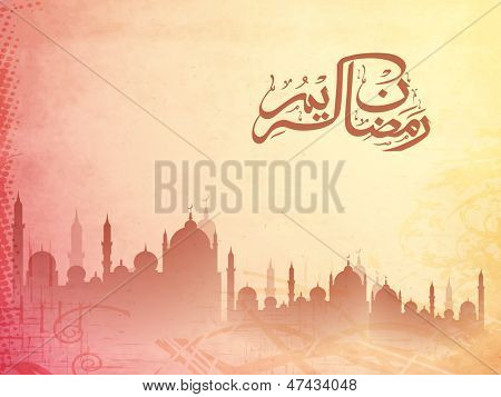 Arabic Islamic calligraphy of text Ramadan Kareem with silhouette of mosque on vintage background.