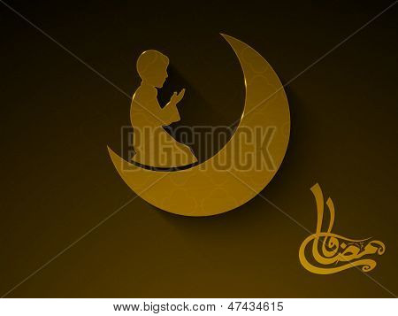 Arabic Islamic calligraphy of text Ramadan Kareem with Muslim boy praying (reading Namaz, Islamic Prayer) with moon on abstract brown background.