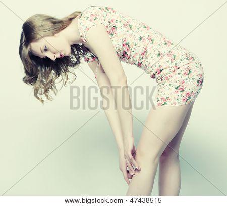 young Woman touching a leg