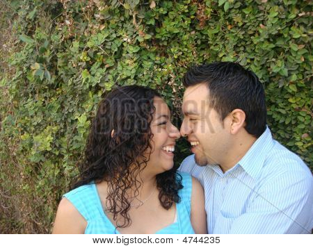 Cute Hispanic Couple Rubbing Noses