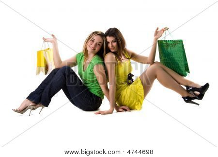 Two Pretty Women Sits With Bags