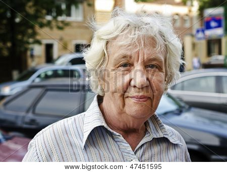 Smiling elderly woman in the city.