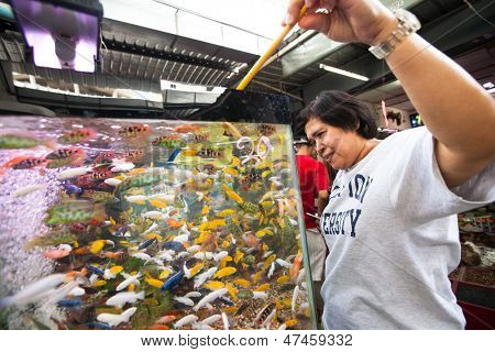 BANGKOK, THAILAND - APR 24: Unidentified seller in fishmarket at Chatuchak Market Apr 24, 2012 in Bangkok, Thailand. Is one of the world's largest markets covering over 35 acres with 15,000 stalls.