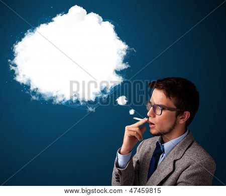 Handsome young man smoking unhealthy cigarette with dense smoke