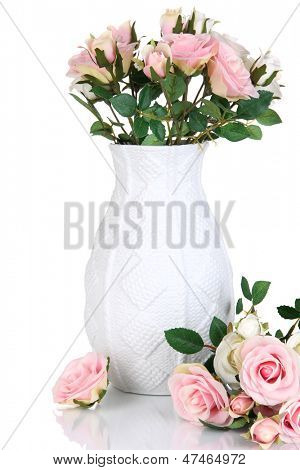 Beautiful pink and white roses in vase isolated on white