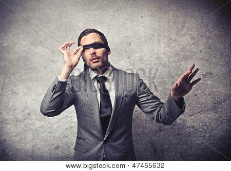 businessman blindfolded