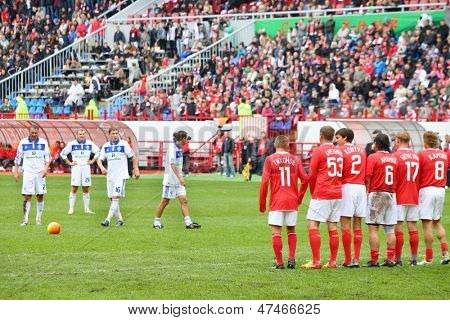 MOSCOW - SEP 9: Preparing for free kick at football match Spartak Moscow (in red) - Dynamo Kiev (in white) at Lokomotiv stadium (Farewell match of Yegor Titov), on September 9, 2012 in Moscow, Russia.
