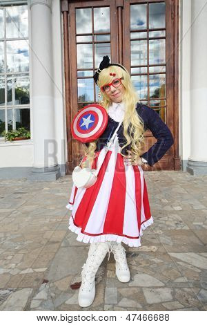 MOSCOW - SEPTEMBER 8: Woman dressed as Captain America at festival Everycon near House of Culture in VVC, on September 8, 2012 in Moscow, Russia.
