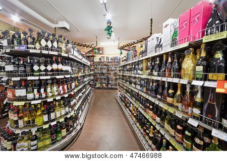 MOSCOW - DEC 8: Department with shelves with alcohol beverages in supermarket of home food Bahetle, December 8, 2012, Moscow, Russia.