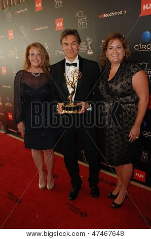 BEVERLY HILLS - JUN 16: Dr. Mehmet Oz with the Outstanding Talk Show Informative award for 'The Dr. Oz Show' at the 40th Annual Daytime Emmy Awards on June 16, 2013 in Beverly Hills, California
