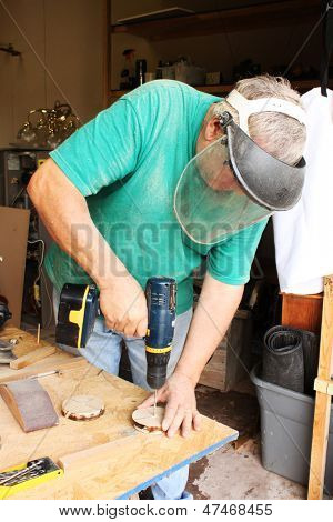 Man working with saw and other carpenter's tools