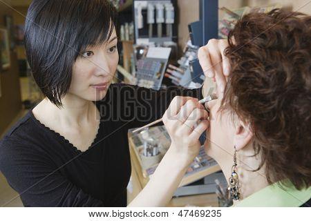 Make up artist performing makeover in salon