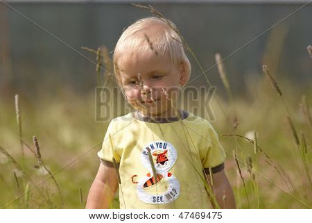 Baby in tall grass