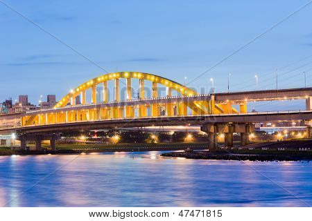 Night scenery of famous attraction landmark, MacArthur bridge, over river in Taipei, Taiwan, Asia.