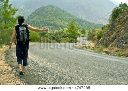 Hitchhiker Thumbing A Lift