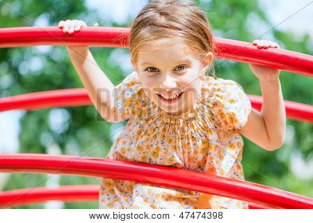 cute little girl on the kids playground
