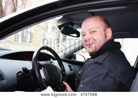 A Man Driving A Car