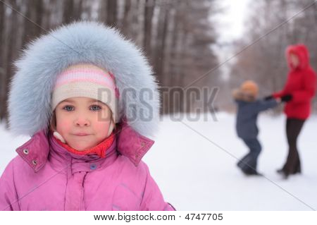 Little Girl In Park In Winter