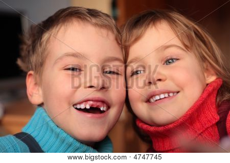 Laughing Boy Without Foreteeth And Smiling Girl
