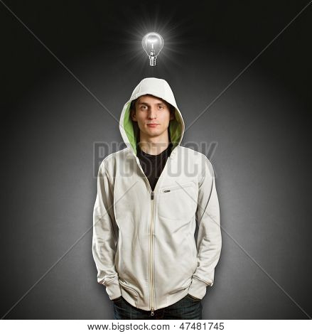 Idea concept. Male, looking on camera, with lamp above his head