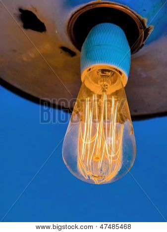 energy saving lamp, symbolic photo for energy conservation, ecology, environmental protection. filament of a gl���¼hbrine