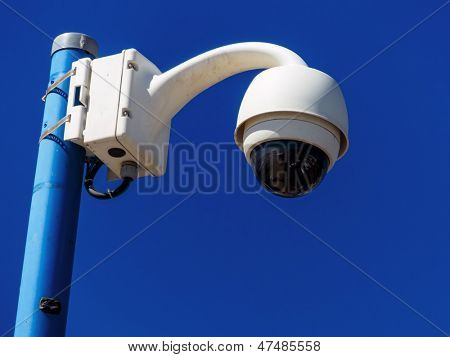 surveillance camera on a wall. cctv part of everyday life