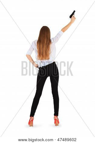 Young Woman With A Pistol. Isolated On White Background.