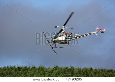 Pilot In-Flight In A Crop Dusting Agriculture Helicopter.