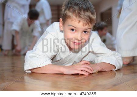 Lying Boy In Sports Hall