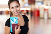 image of cheer up  - close up portrait of young businesswoman at airport holding flight ticket - JPG